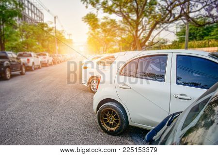 Car Parked On Street,car Parked On Road,cars A Lot On Road At Sunlight And Cars Row On Road