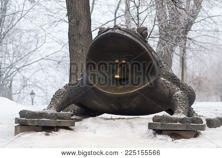Kyiv, Ukraine - Jan 01, 2017: Monument of a Giant toad in Mariinski Park. Money Toad by Oleg Pinchuk with coins under the feet is a symbol of financial well-being. Selective focus. Artistic blurring