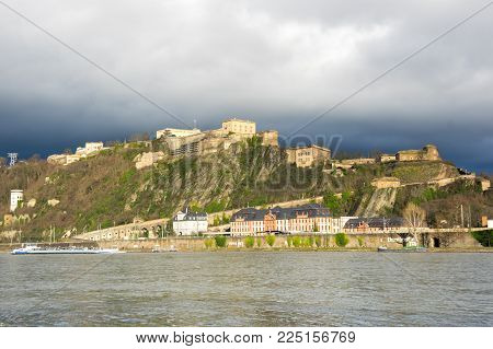 KOBLENZ, GERMANY - FEBRUARY 21, 2016: Fortress Ehrenbreitstein as seen from Koblenz, a city situated on both banks of the Rhine at its confluence with the Moselle, Germany