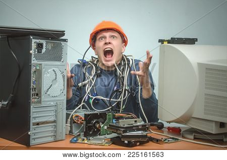 Overloaded computer repairman tired from his work and goes crazy. Computer technician. PC repair service center. poster