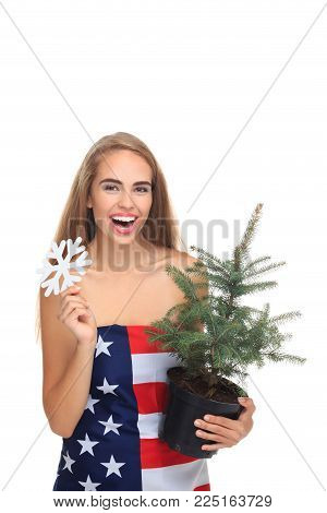 Lady holding evergreen tree. USA X-mas. Holidays .Lady in american flag. New Year