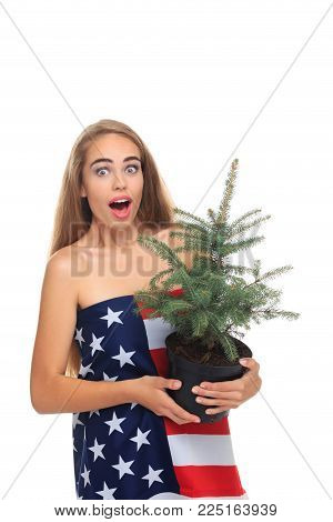 USA X-mas. Holidays .Emotional girl holding christmas tree.