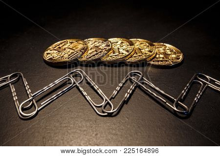 Block chain concept a photo of the gold coin and paper clips  connected in one chain