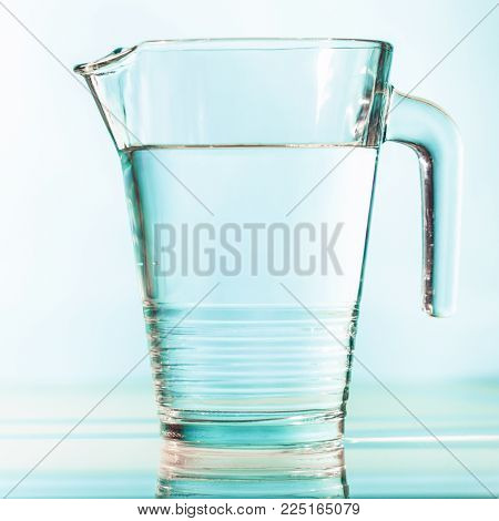 Water diet concept on a turquoise background. The picture can also be used to illustrate the problem of lack of clean drinking water.
