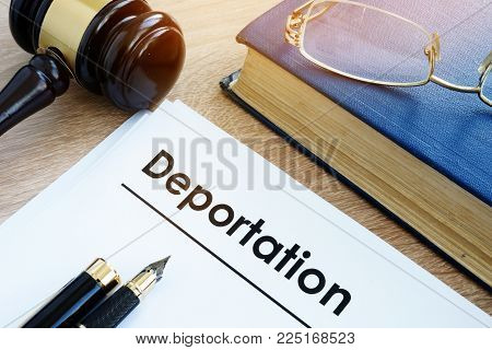 Deportation And Other Documents On A Desk.