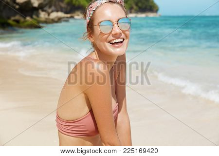 Marine Paradise. Happy Relaxed Female In Sunglasses And Swimsuit Being Glad To Spend Summer Holidays
