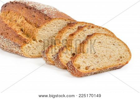 Partly sliced loaf of the wheat and rye sprouted bread with added whole sprouted wheat grains, rye malt and molasses at selective focus on a white background