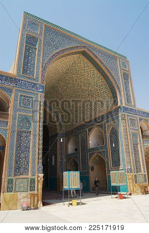 YAZD, IRAN - JUNE 17, 2007: Unidentified people visit Jameh mosque in Yazd, Iran.