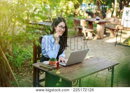 Beautiful Woman Working With Laptop In The Cafe