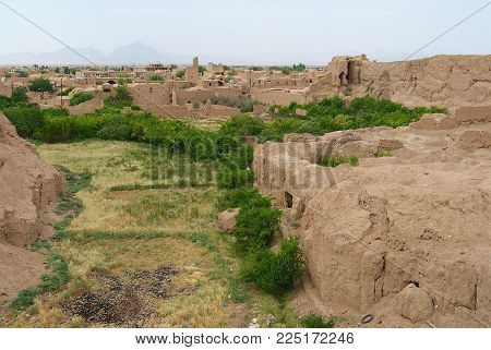 YAZD, IRAN - JUNE 17, 2007: View to the ruins of the old clay buildings in the suburbs of Yazd, Iran.