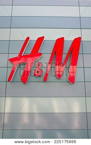 Bracknell, England - February 04, 2018: H & M shop sign on the outside of the fashion store in Bracknell, England. Originally from Sweden, H&M opened their first store in London in 1976