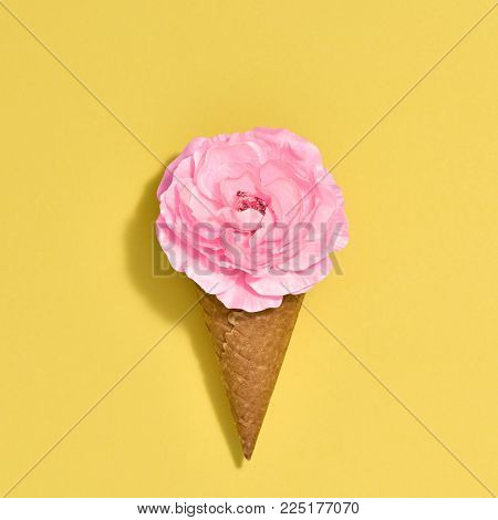 Ice Cream Cone with Pink Flower. Creative Minimal. Yellow Rose, Bright Color. Spring Summer Floral concept. Trendy fashion Style. Art Vintage