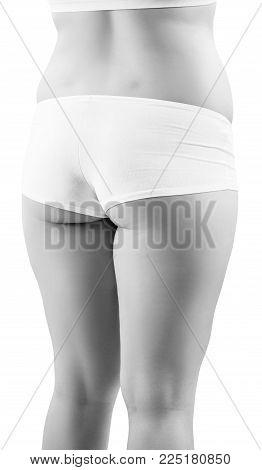 Fatty female buttocks in white underwear isolated on white background.
