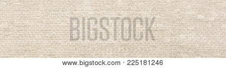 Vintage whitewashed brick wall panoramic background texture.