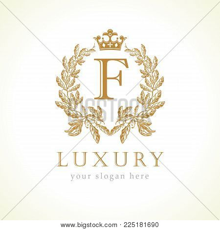 Luxury F letter and crown monogram logo. Laurel elegant beautiful round identity with crown and wreath. Vector letter emblem F for Antique, Restaurant, Cafe, Boutique, Hotel, Heraldic, Jewelry