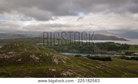 An aerial view over Loch Torridon in the northwest of Scotland and the Highlands on a grey and overcast day.