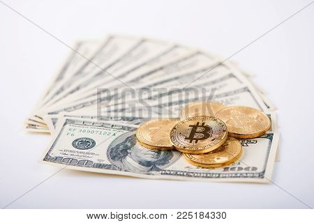 Money comaprison. Golden bitcoins as innovative futuristic virtual money and hundred dollar banknotes as old form of money. Cryptocurrency digital electronic web mining exchange blockchain finance