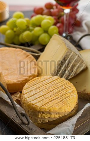 Tasting Of Oldest French Aoc Soft Pudgent Yellow Cheese Livarot,  Munster And Semifirm Tomme French