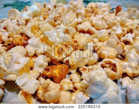 photo tender yellow appetizing popcorn grains close-up with bokeh effect.