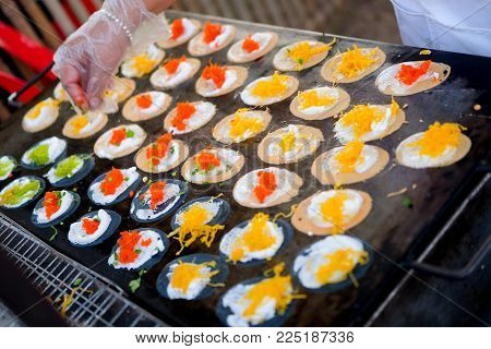 Thai People Cooking Ancient Indigenous Called Thai Sweetmeat Khanom Bueang (a Kind Of Filled Pancake