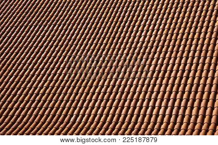 Roof of a house covered with new red tiling