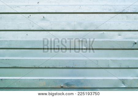 Industrial Metal Background. Corrugated Zinc Metal Texture. Corrugated Zinc Texture Of Metal Fence,
