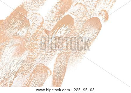 Trendy makeup background. Brush strokes of liquid fluid foundation on white, copy space