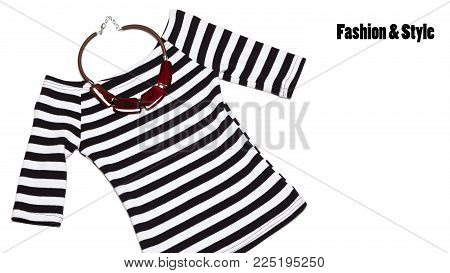 Trendy striped top with necklace on white background, flat lay. Fashion & style minimal concept, free space for text