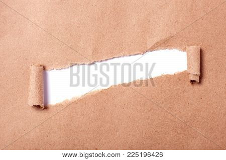 Kraft paper with a hole in the form of a line. Hole isolated on white