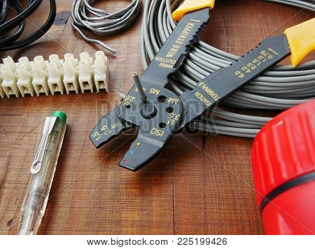 Cutting cable with cable cutter. Vintage hand tools for electrical work DIY repair and installation