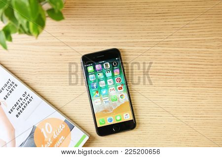 KYIV, UKRAINE - DECEMBER 5, 2017: iPhone 8 Space Grey with home screen on table
