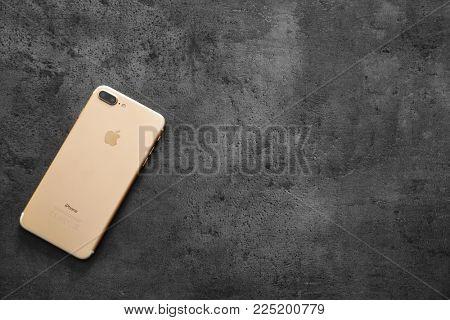KYIV, UKRAINE - NOVEMBER 21, 2017: iPhone 7 Plus Gold on grey background