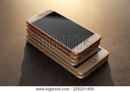 KYIV, UKRAINE - OCTOBER 19, 2017: iPhone 7 Rose gold on stack of smartphones