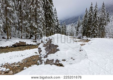 Rocks and snow on a winter landscape of French Alps