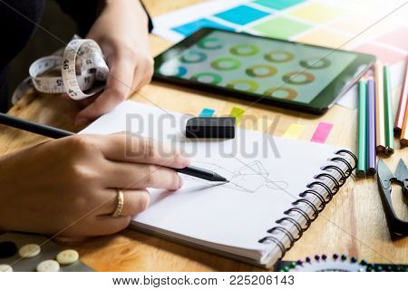 Young Women Working As Fashion Designer Drawing Sketches For Clothes In Atelier Paper At Workplace S