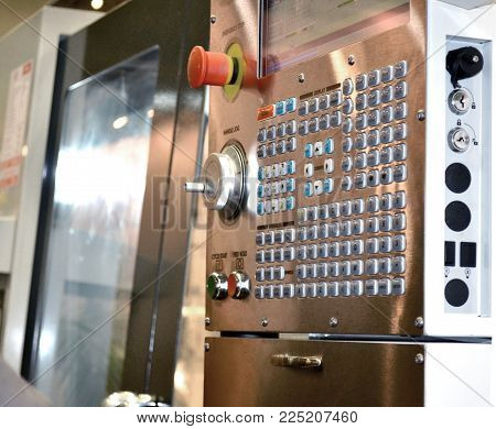 Large button on the control panel industrial machine close-up. Industrial machinery, production aggregation and equipment mechanical automaton facilities, machine tools lathes. Industrial technologies