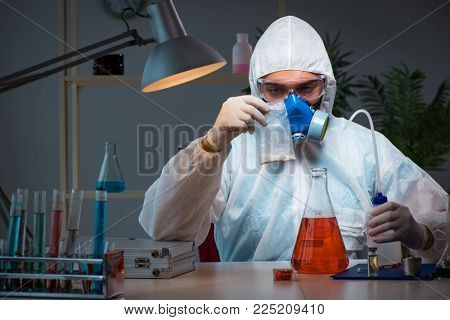 Young make scientist working with dangerous hazardous substances