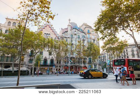 Barcelona, Spain - August 25, 2014: Ordinary people walk on Passeig de Gracia one of the major avenues in Barcelona, Catalonia