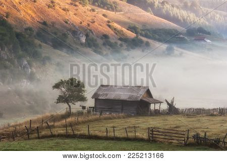 Beautiful rural mountain landscape in the misty morning, Fundatura Ponorului, Hunedoara County, Romania