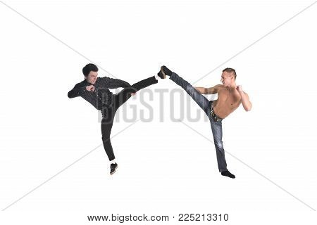 A young boy and man portrayed karate isolated on white background for any purpose