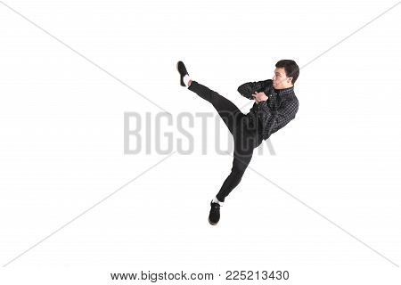 Kick roundhouse kick jumping isolated on white background for any purpose