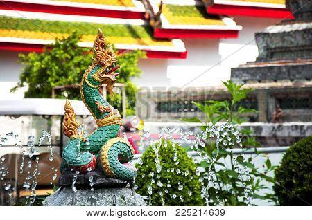 Bangkok, Thailand, territory of the temple Wat Arun Ratchawararam Ratchawaramahawihan or Wat Arun is a Buddhist temple. Fragment of dragon sculpture.