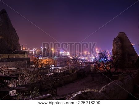 Night Scene Of The Uchisar Castle In Cappadocia. Illuminated View Of Famous Uchisar Village, Distric
