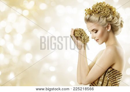 Fashion Model Hold Gold Jewelry in Hands, Woman Beauty Hairstyle and Golden Crown in Hair, Beautiful Girl Holding Jewellery