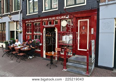 Amsterdam, Netherlands - July 7, 2017: People Dine At A Restaurant In Amsterdam, Netherlands. Amster