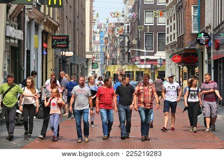 Amsterdam, Netherlands - July 7, 2017: People Visit Nieuwendijk Shopping Street In Amsterdam, Nether