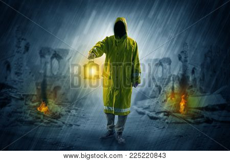 Destroyed place after a catastrophe with man in raincoat and lantern concept