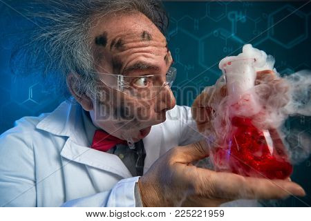 crazy scientist hysteric looking at exploded experiment