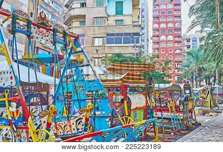 Alexandria, Egypt - December 17, 2017: The Retro Fun Rides For Little Children In Luna Park Of Anfou