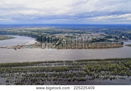 Spring floods on the Siberian river Irtysh. In the flood zone - village of Gornopravdinsk, Yugra